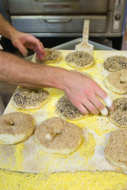 Lou Slingerland puts seeds on Scratch's highly sought after bagels.